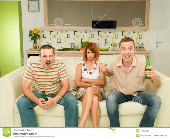 friends-watching-exciting-game-two-men-sitting-couch-television-kitchen-holding-beers-screaming-upset-women-44455038