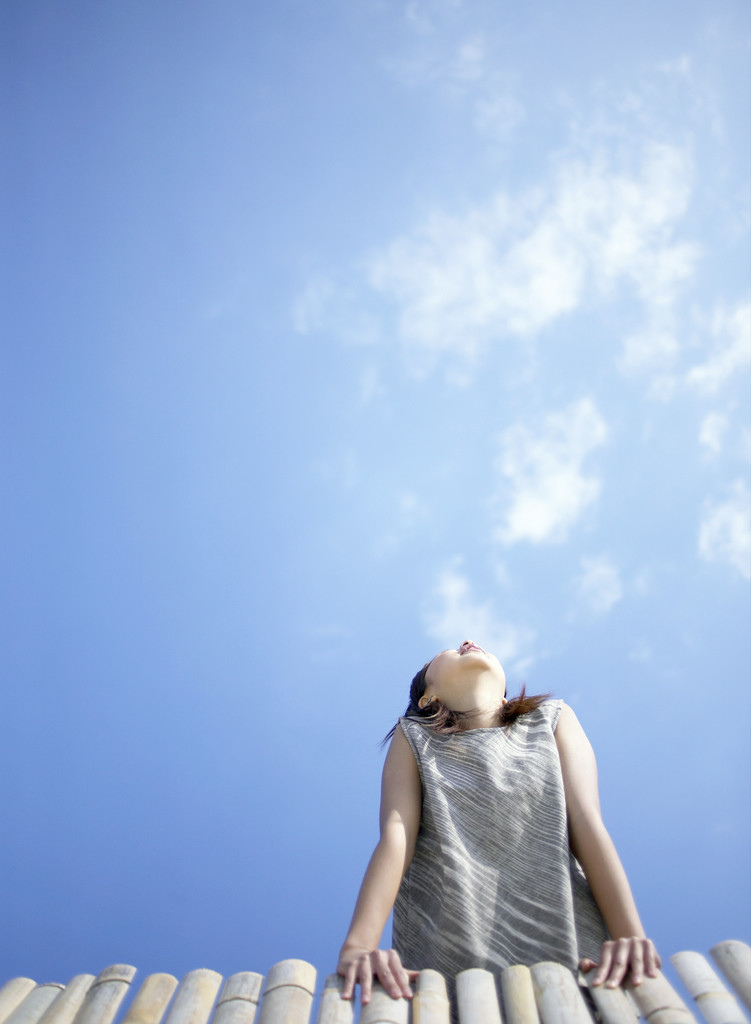 Girl Looking at the Sky --- Image by © Royalty-Free/Corbis